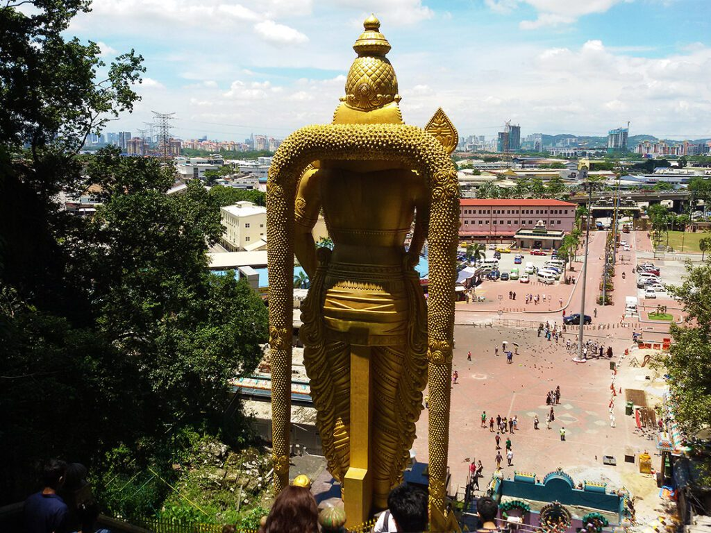 View of Kuala Lumpur from the most imposing landmark - the Lord Murugan Statue in front of the Batu Caves in the district of Selangor.