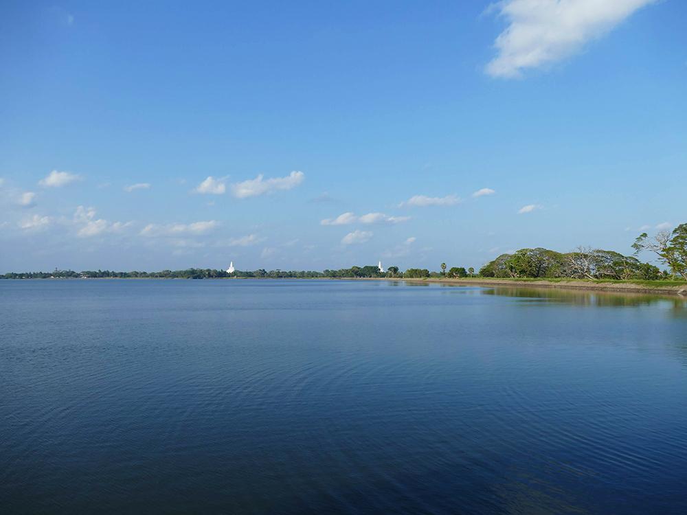 View of two Stupas - Thuparamaya and Ruwanwelisaya - across lake Thissa Wewa in Anuradhapura