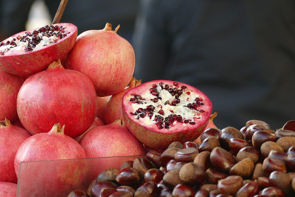Pomegranate and chestnuts on the market in Athens