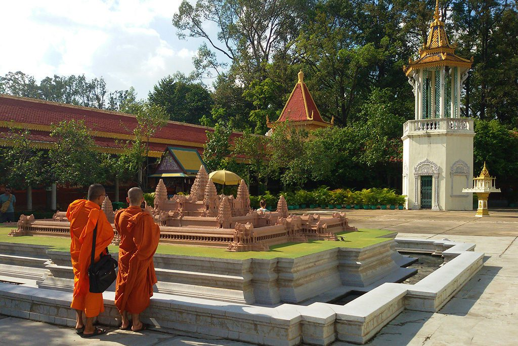 Two monks admiring the model of Angkor Wat at the Preah Vihear Preah Keo Morakot at Phnom Penh