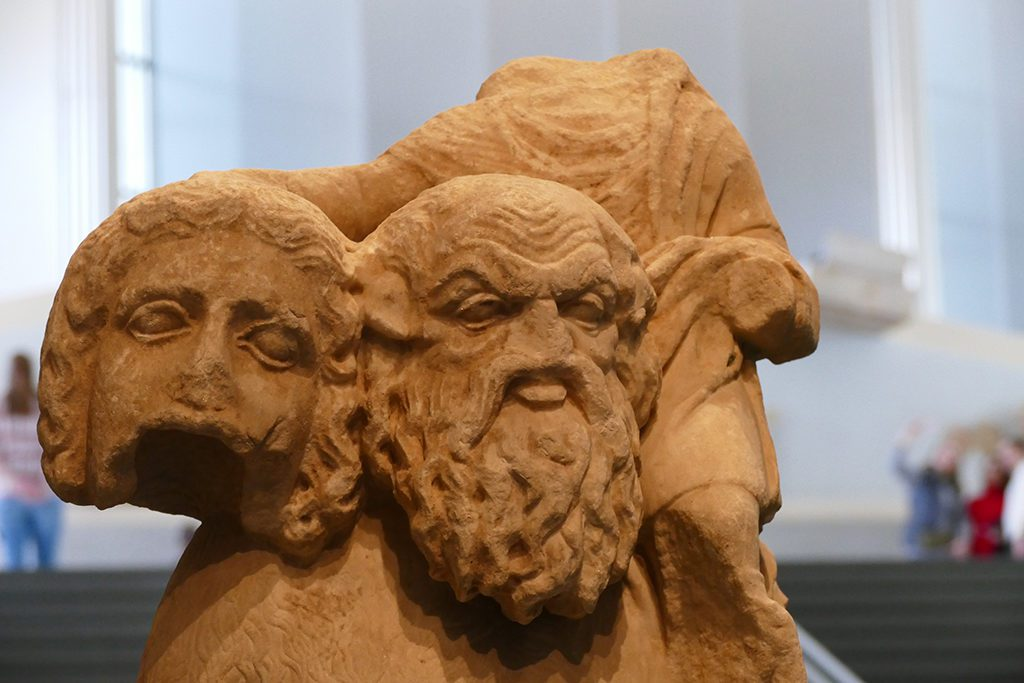 A statue of the mythical Satyr Silenus from the the 2nd century BC. The wise teacher is carrying on his shoulder the wine god Dionysos holding a theatrical mask.