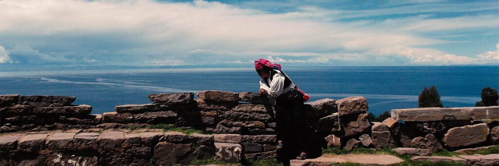 man overlooking the titicaca lake