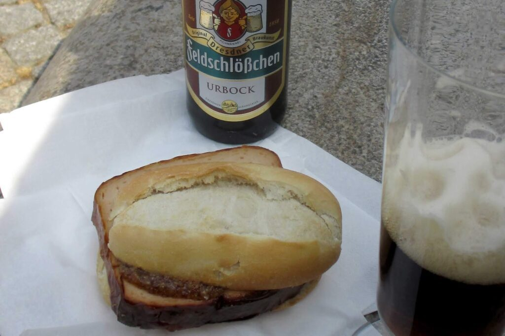 Fleischkäsesemmel and a beer in Munich - something everyone must try when for 24 hours in Munich