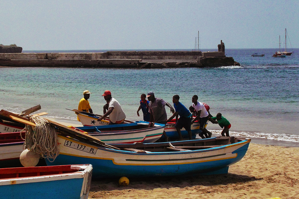 Fishermen bringing in a boat at Tarrafal in the north of Cape Verde's main island Santiago