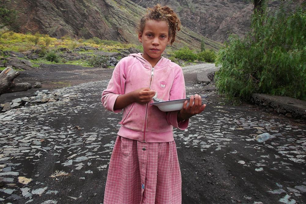 Little girl selling pepper on the island of Fogo