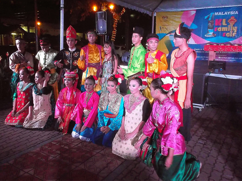 Group of Dancers reprsenting MALAYSIA - a Complete Guide to Asia's Cultural Melting Pot