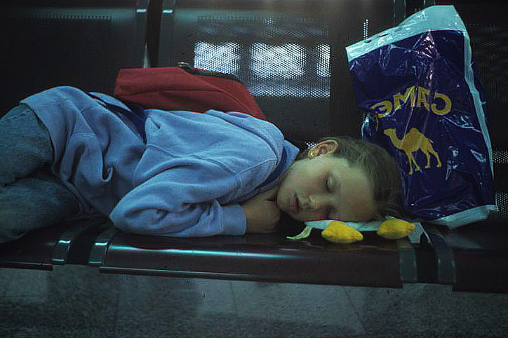 Child sleeping at an Airport