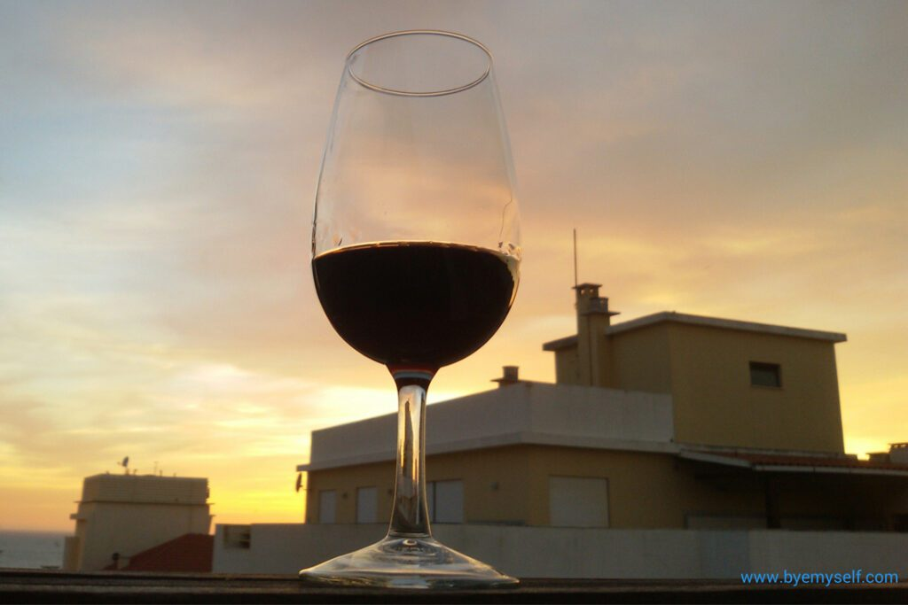 A glass of Porto enjoyed on the balcony of the Universal Boutique Hotel in Figueira da Foz.