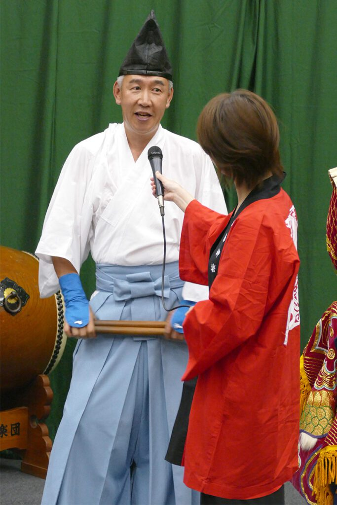 A Kagura-drummer being interviewed during the night at the Kagura