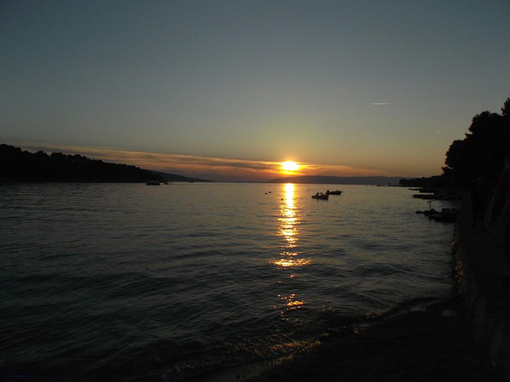 At the end of a perfect day, the sun sets perfectly over the Adriatic sea.