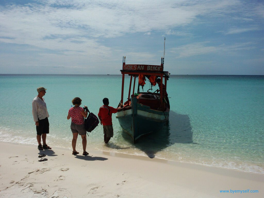 People taking a boat on Sok San Beach on the the island of Koh Rong.