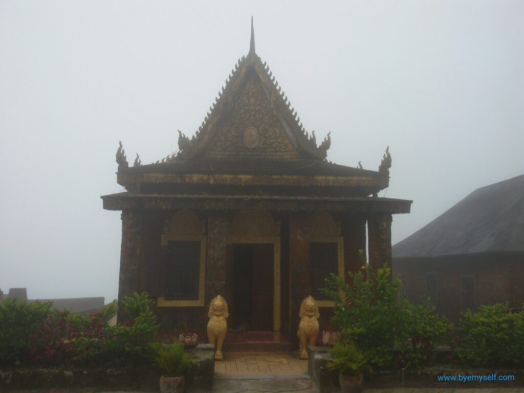 Mold-covered building on the Thansur Bokor in the mist.