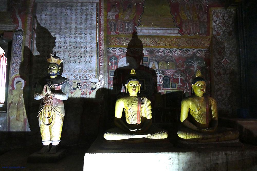 King Nishshanka Malla together with Buddha statues at the cave temple in Dambulla.