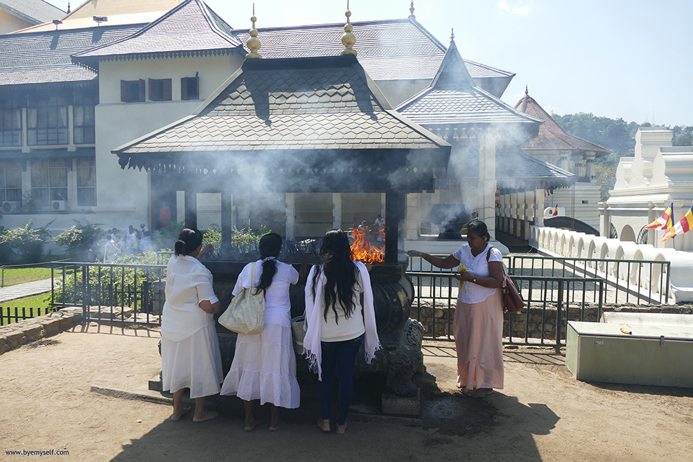 The faithful burning joss sticks at the Sri Dalada Maligawa complex.