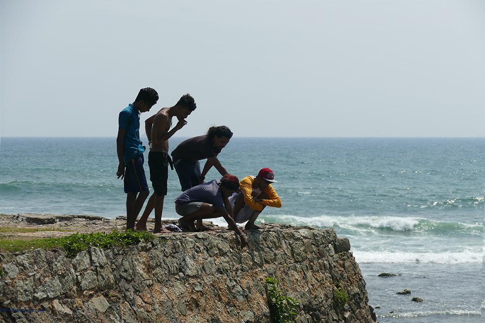 Guys on the Neptun bastion in Galle Fort Sri Lanka