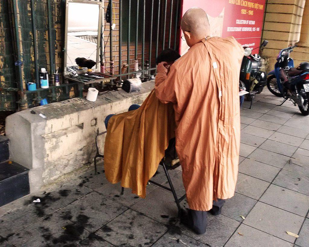 Ambulant barber in Hanoi.